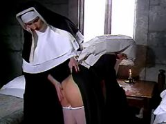 Lustful lesbo nun spoils innocent girl in cell